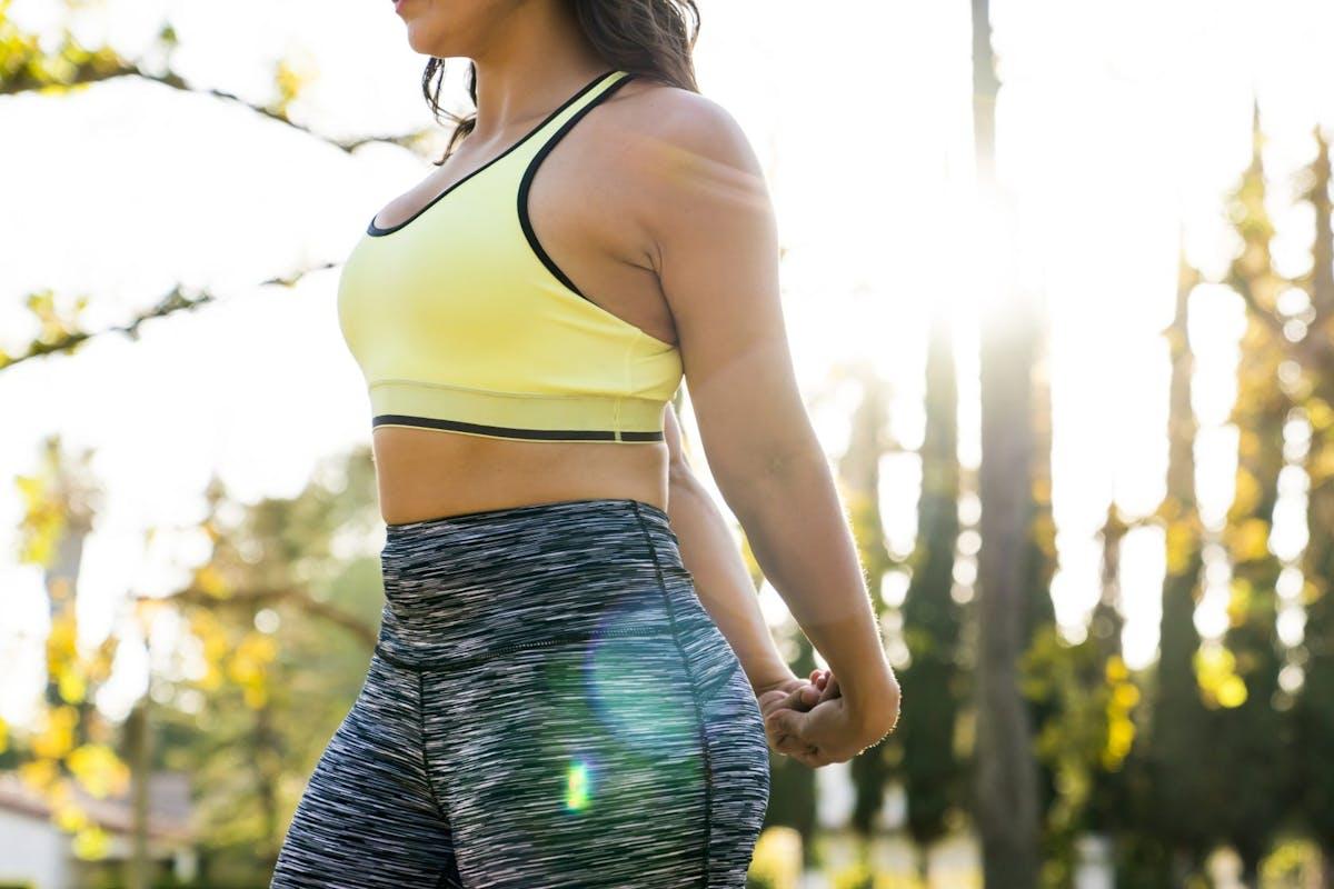 Woman wearing a yellow sports bra