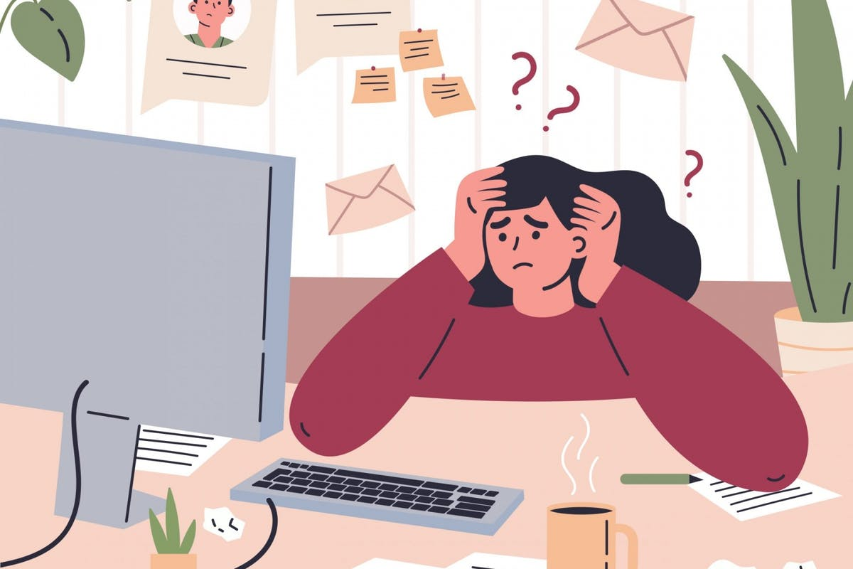 A woman stressed while working from home