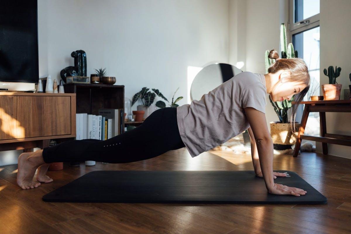 Woman doing a press up on a yoga mat