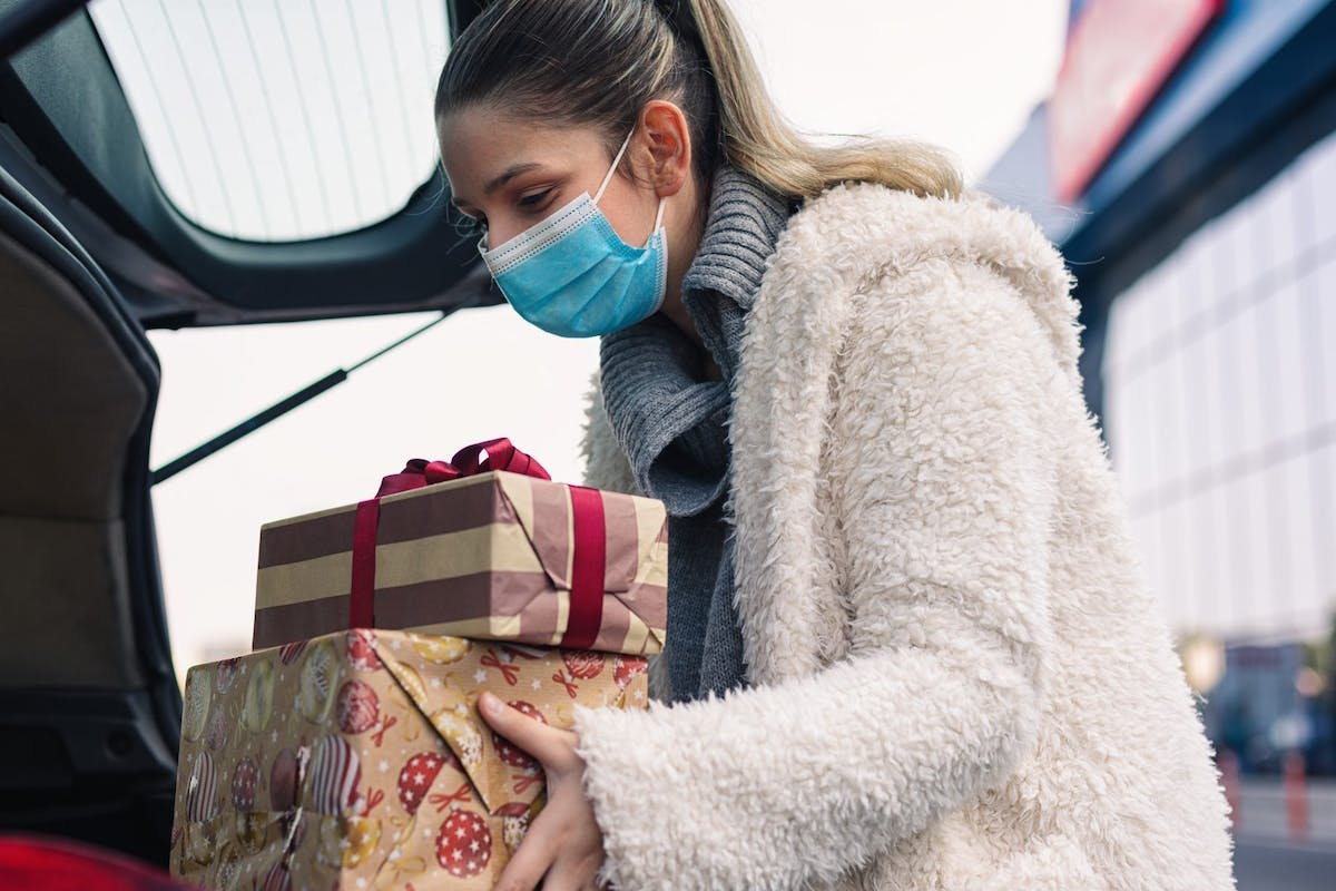 Woman packing presents in her car