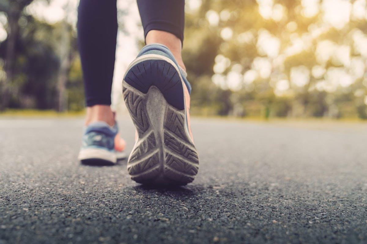 woman walking in walking trainers outdoors