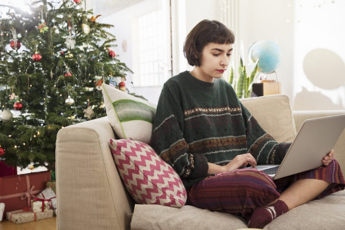 A girl working from home at Christmas