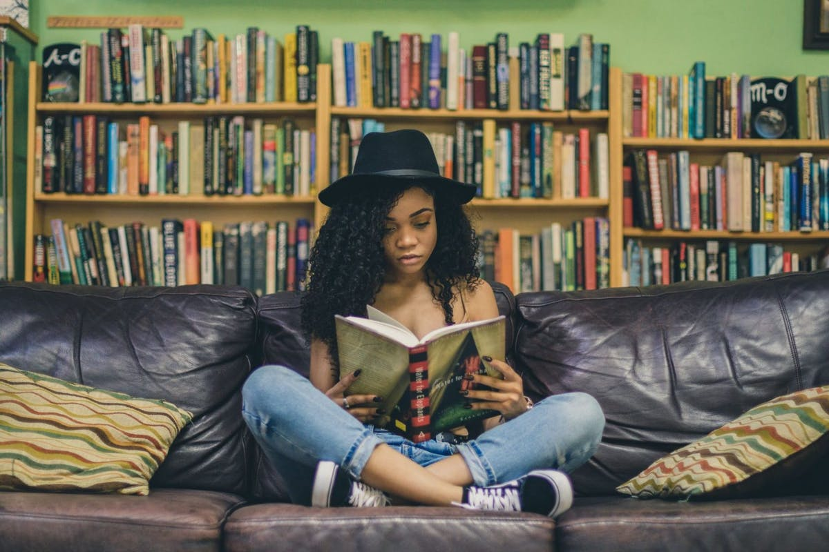 Woman reading book in bookshop