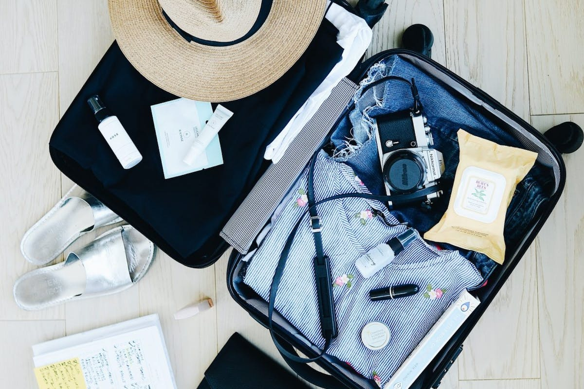 A suitcase packed with holiday items