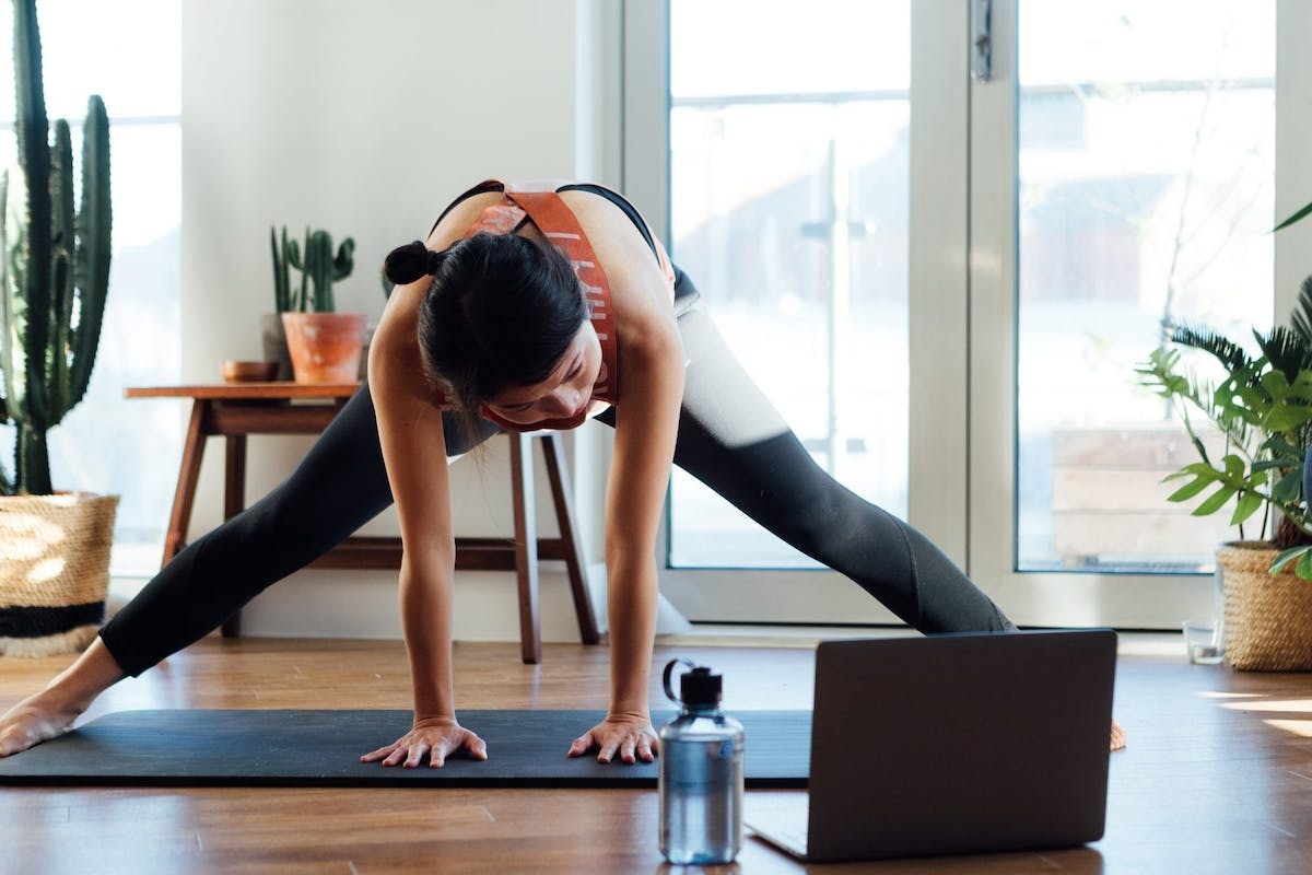 Woman working out from home