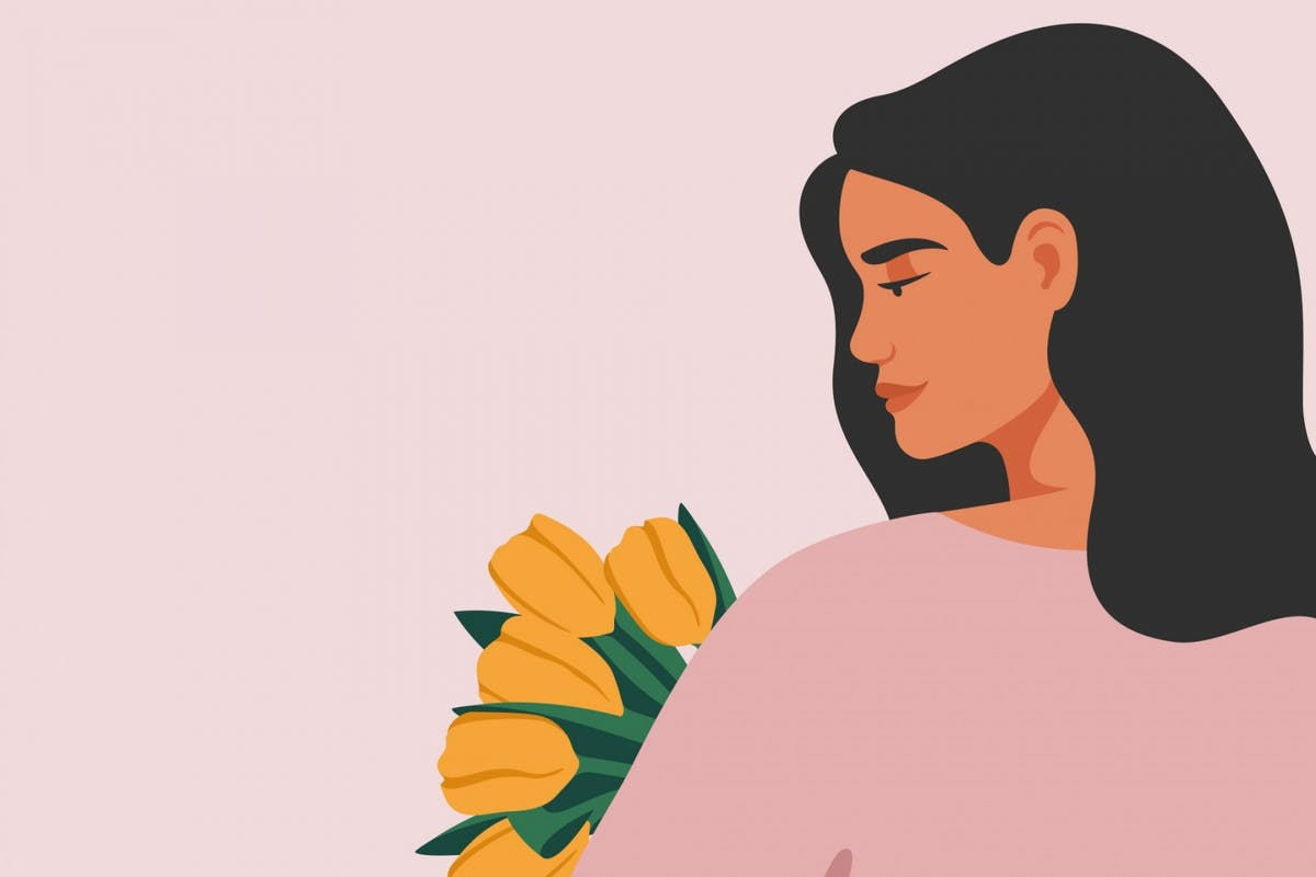 A woman looking at some flowers