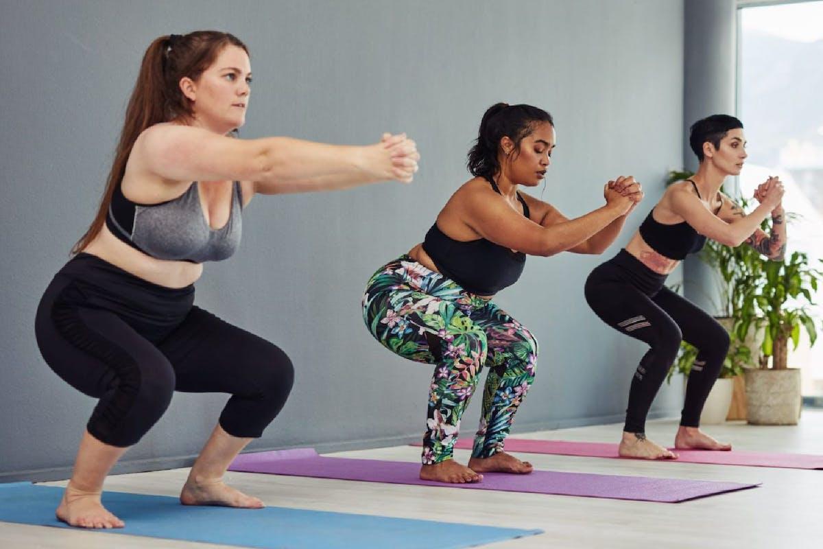 women squatting in fitness class