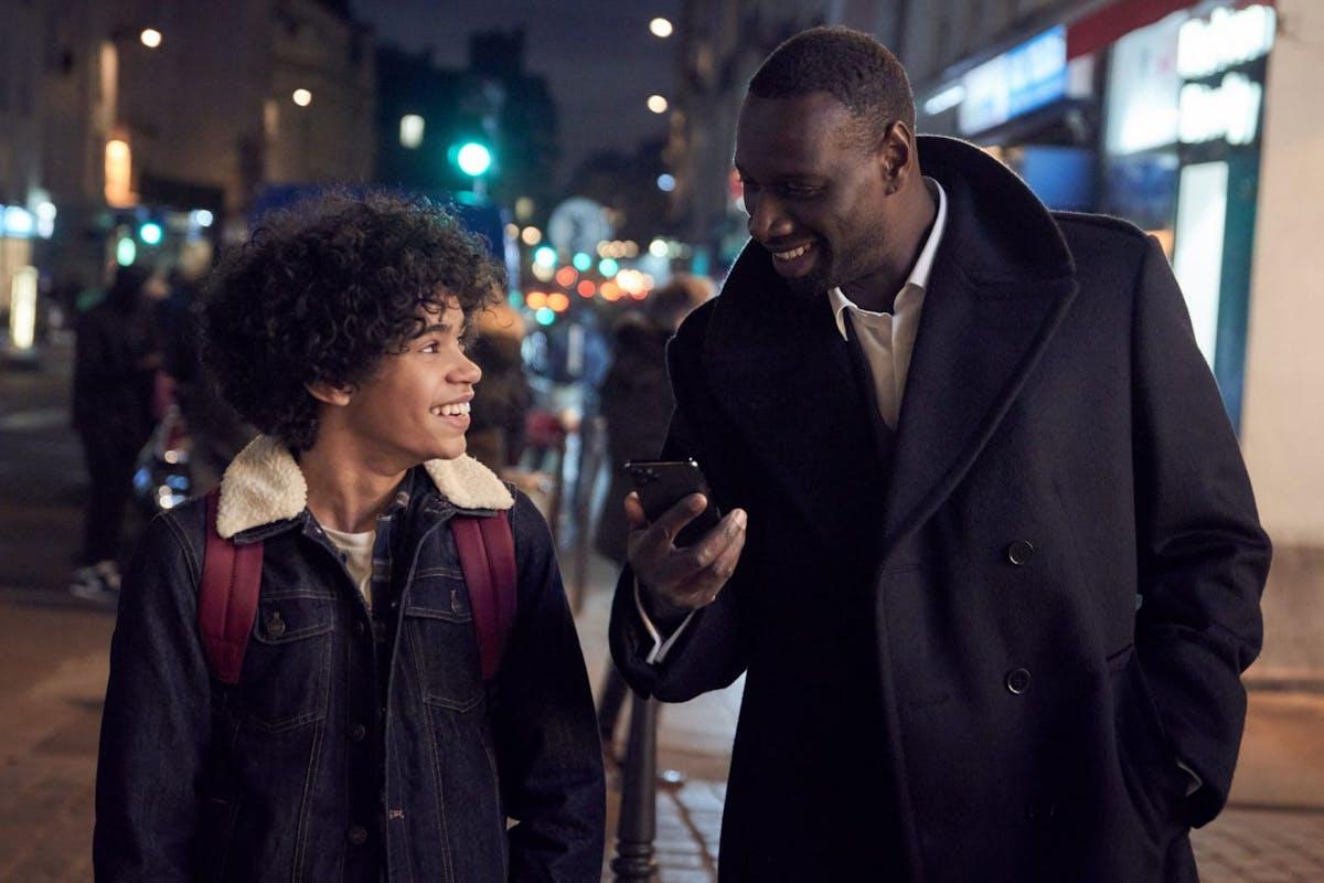 Etan Simon and Omar Sy share a scene in Netflix's Lupin.
