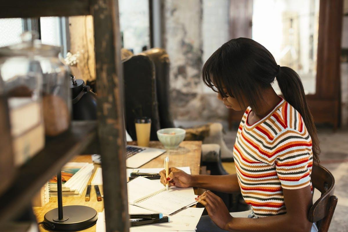 A woman writing a to-do list