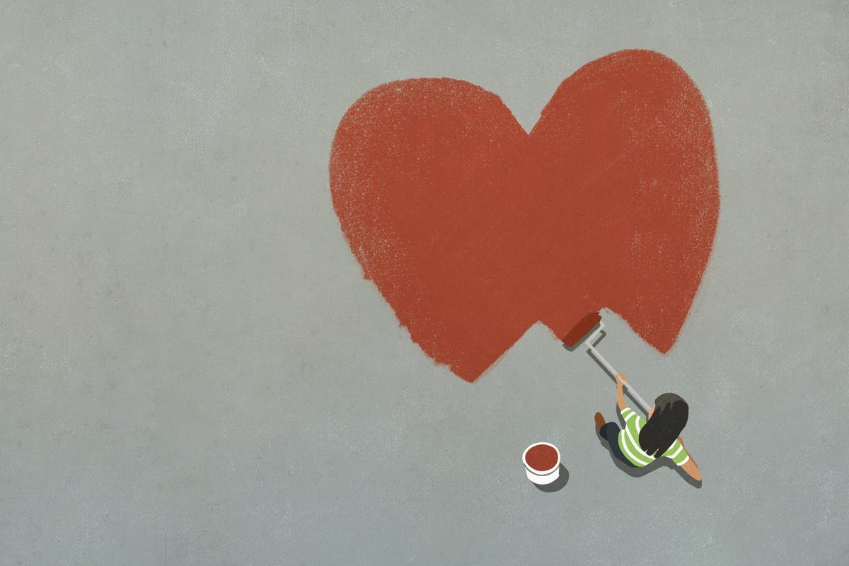 Woman painting a red heart