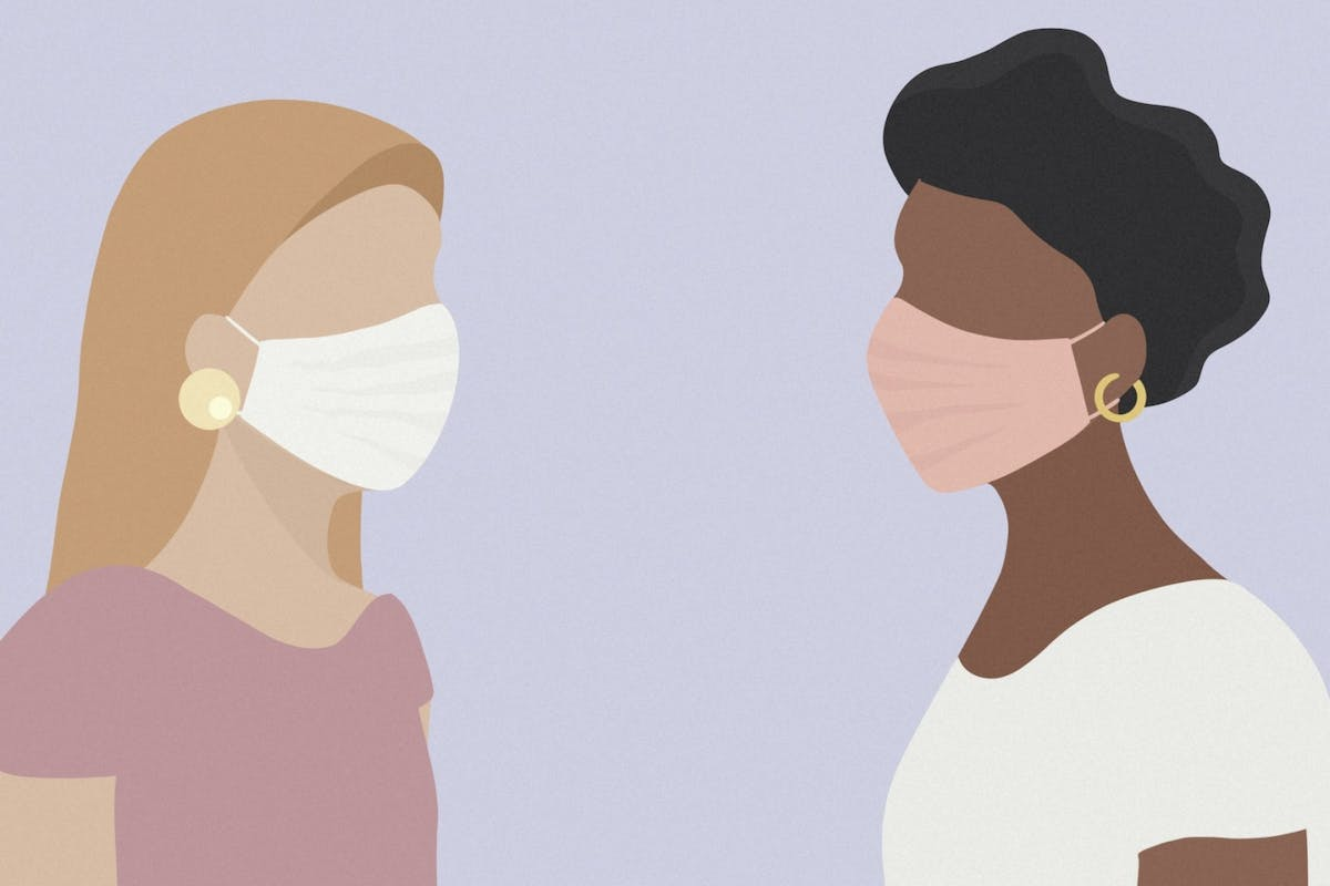 Two women wearing masks facing each other during the pandemic