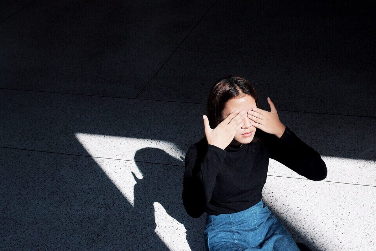 Woman covering her eye