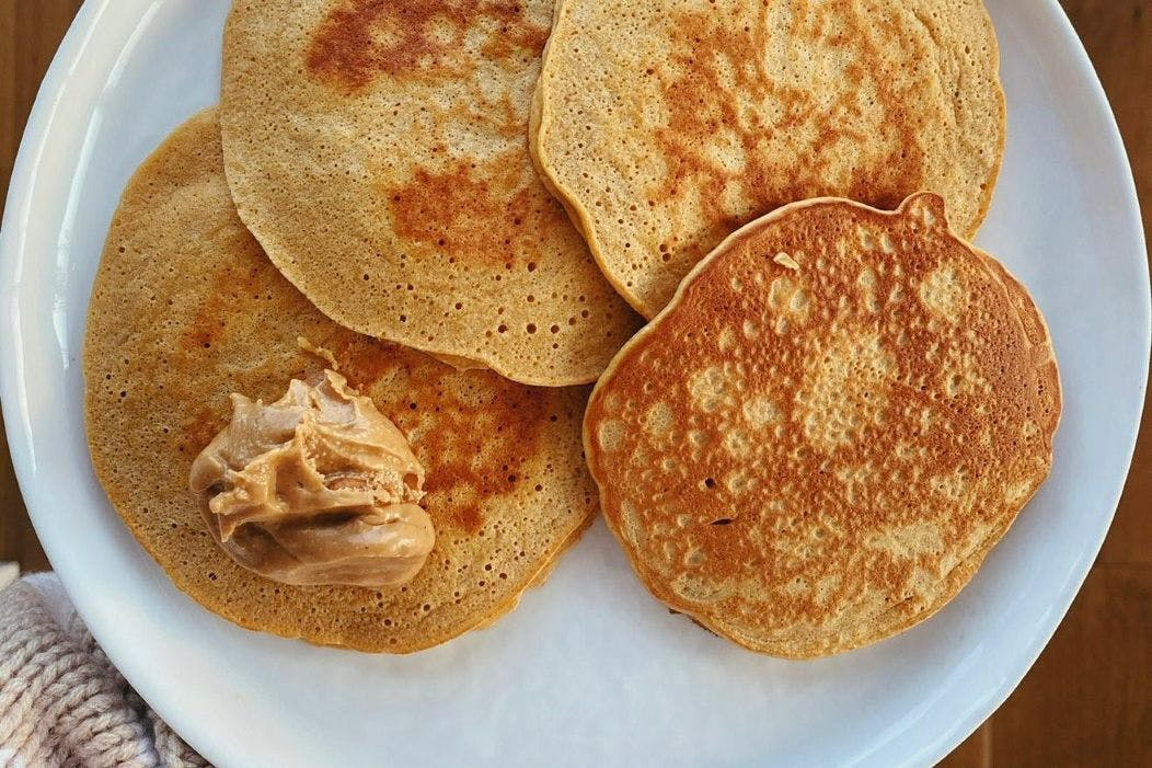 Protein pancakes made from protein powder and eggs with nut butter on top