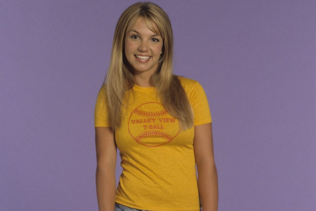 Britney Spears poses during a portrait session on May 1, 1999 in Los Angeles, California.