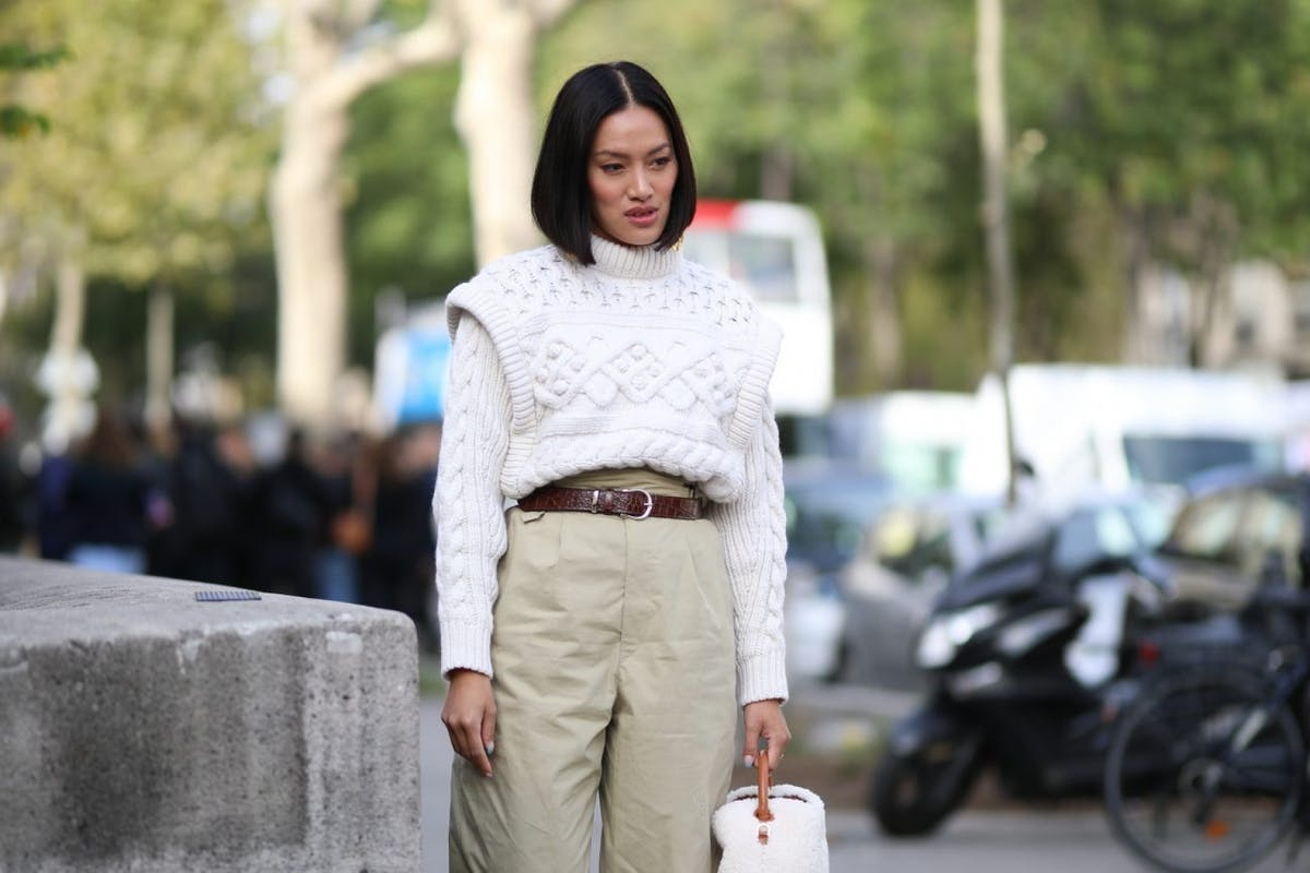 Street style wearing cable jumper