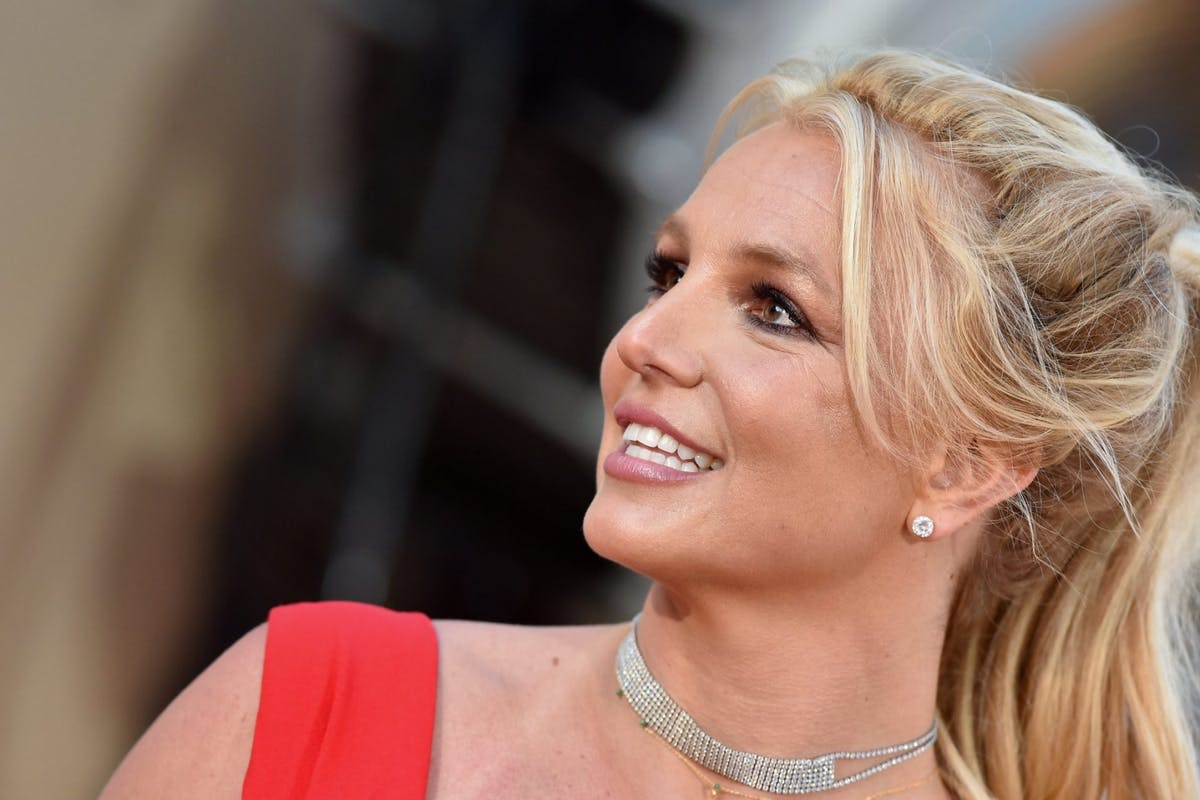 A close-up of Britney Spears on the red carpet wearing a red dress