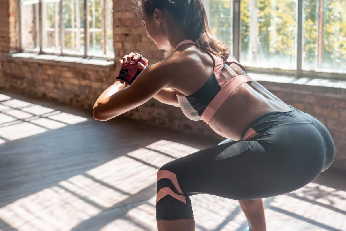 Squat jumps are part of this simple lower body HIIT workout for strength and fitness