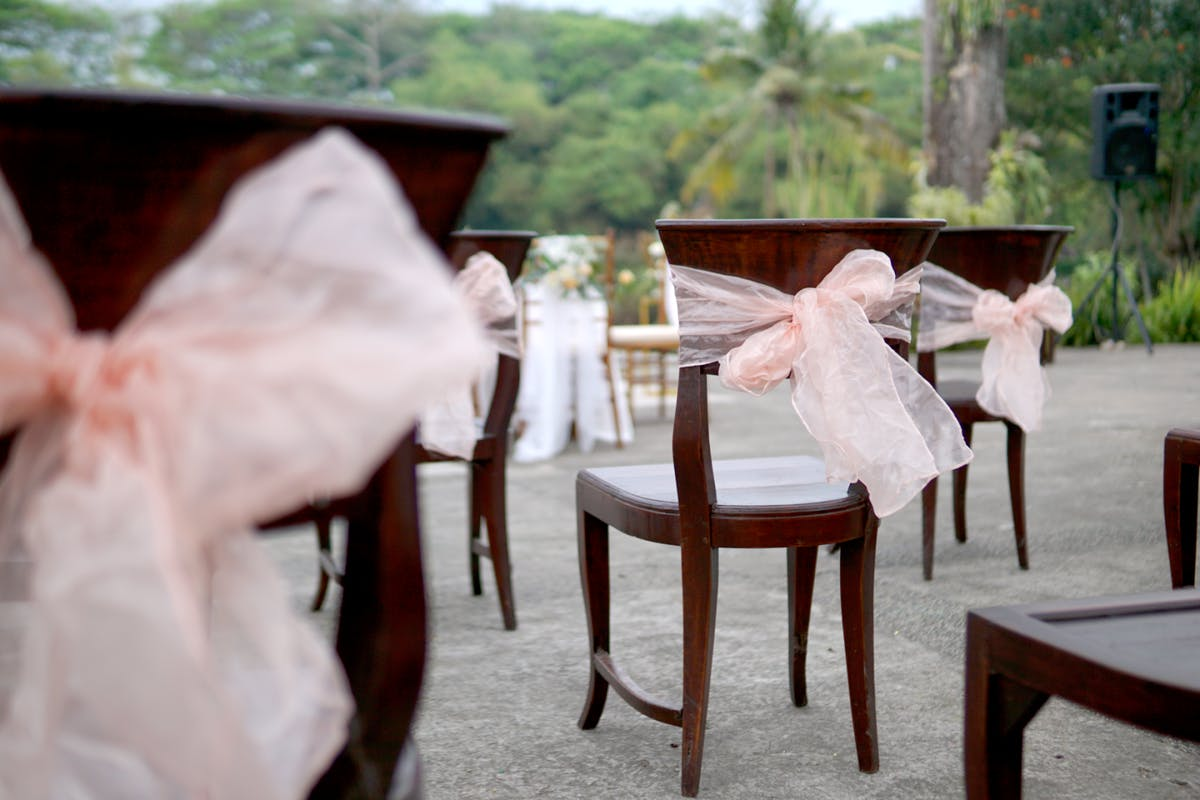 Guest chairs arranged at a social distance for an outdoor wedding
