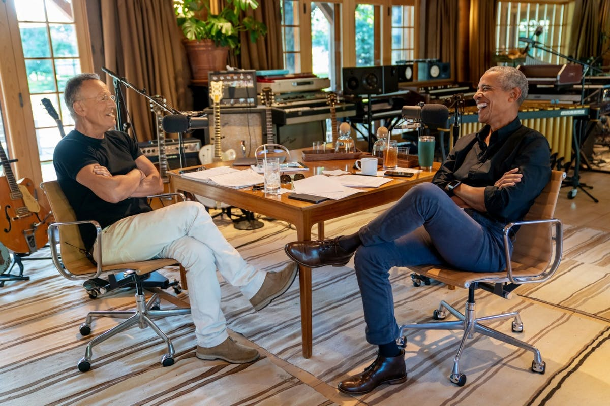 Bruce Springsteen and Barack Obama sat opposite each other in a recording studio recording the Renegades: Born In The USA podcast