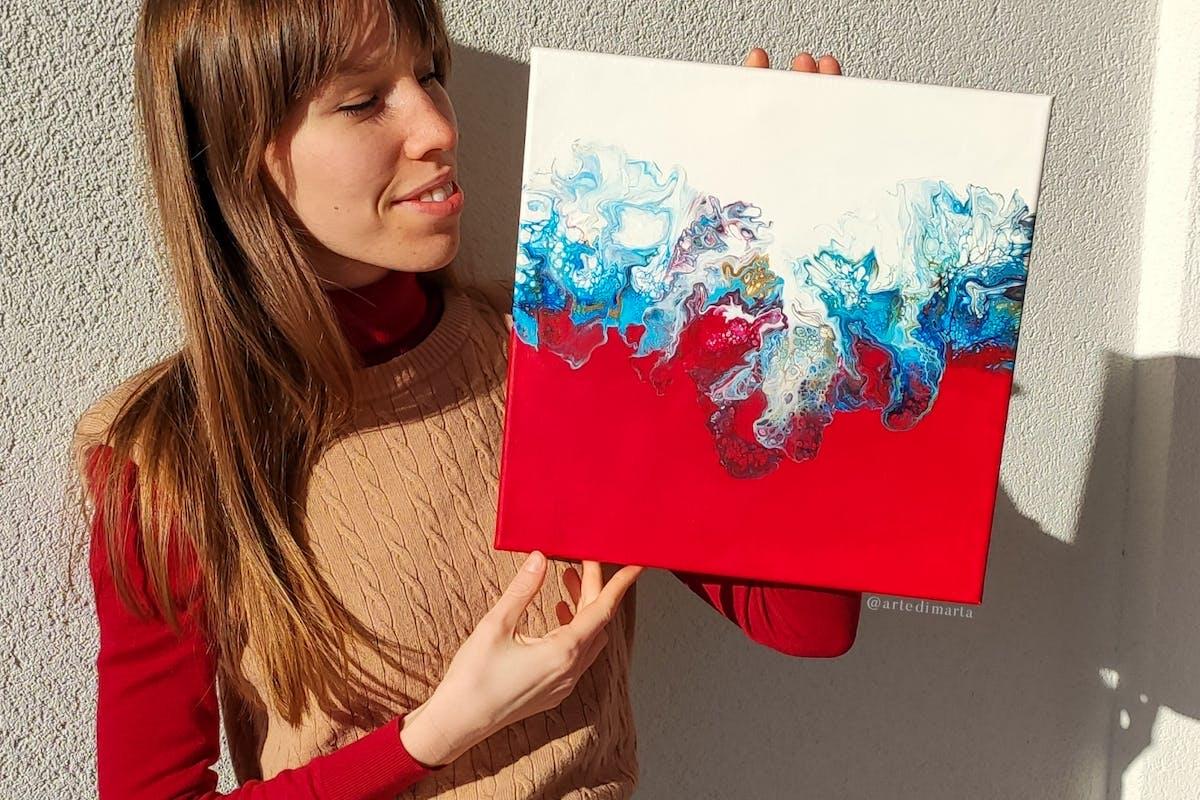 Woman holding a Dutch pour painting