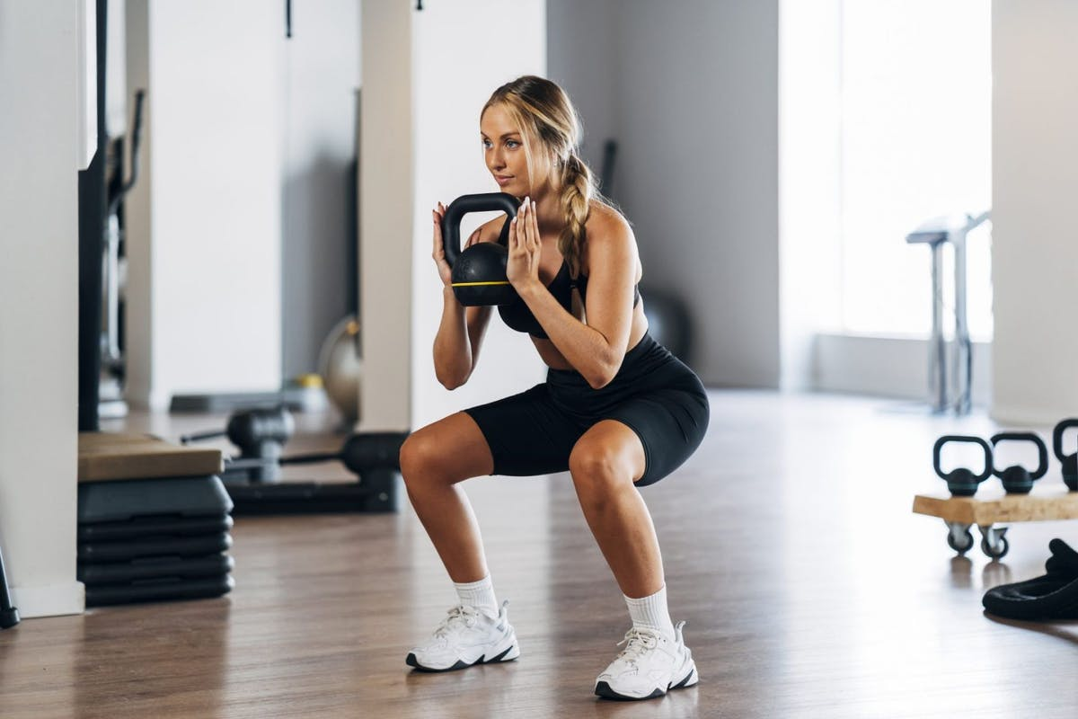 How to squat properly to activate your glutes