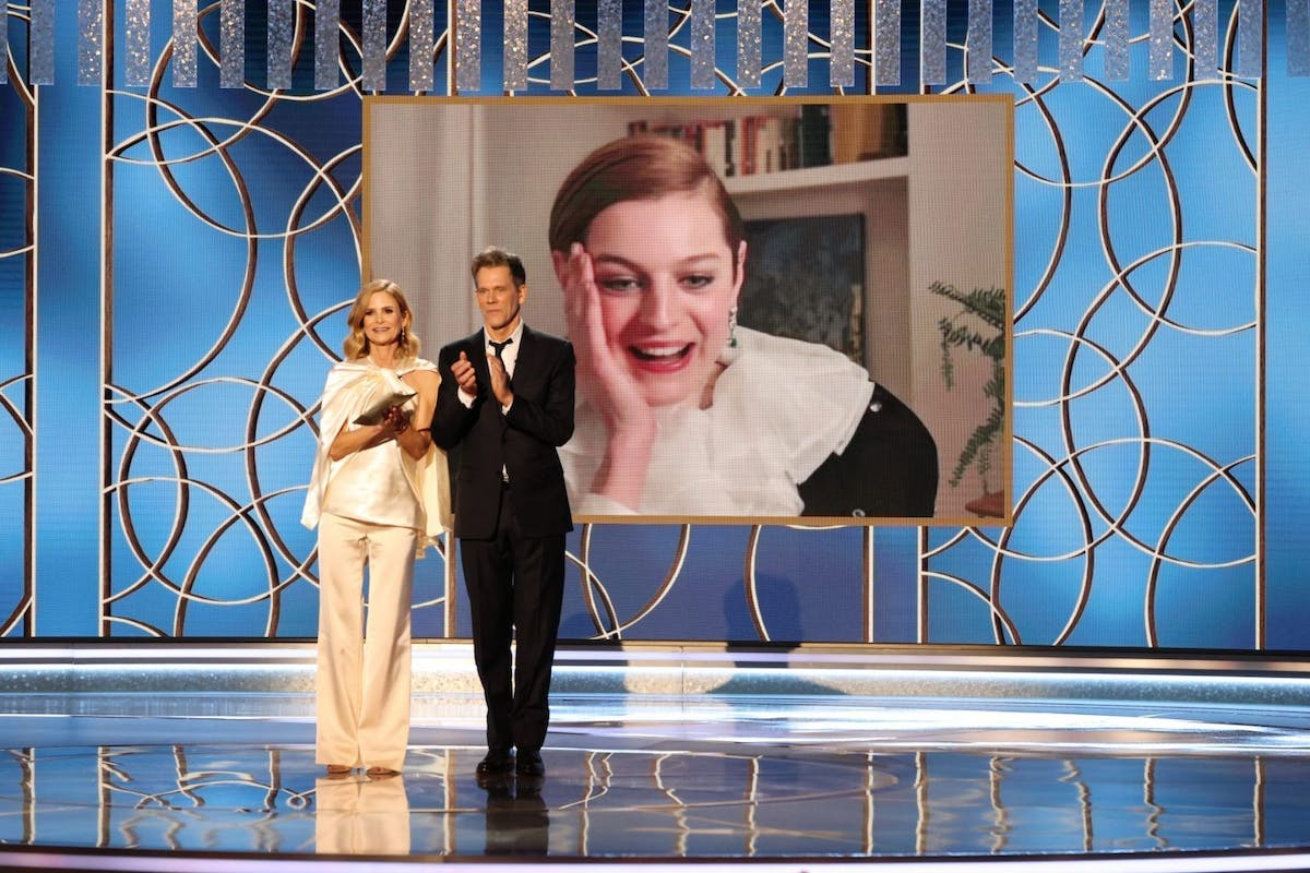 Emma Corrin (c) accepts the Best Television Actress – Drama Series award for 'The Crown' via video from Kyra Sedgwick (l) and Kevin Bacon onstage at the 78th Annual Golden Globe Awards held at The Beverly Hilton and broadcast on February 28, 2021 in Beverly Hills, California. -- (Photo by Christopher Polk/NBC/NBCU Photo Bank via Getty Images)