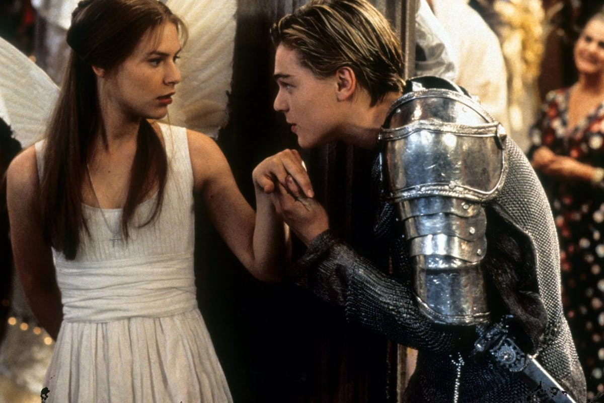 Claire Danes is surprised as Leonardo DiCaprio takes her hand to kiss in scene from the film 'Romeo + Juliet', 1996. (Photo by 20th Century-Fox/Getty Images)