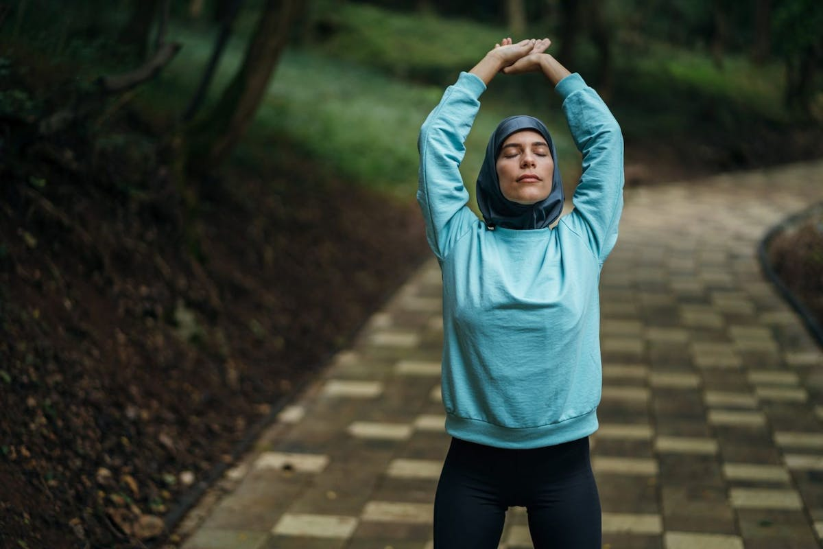 Woman stretching her stomach out during a run outside.