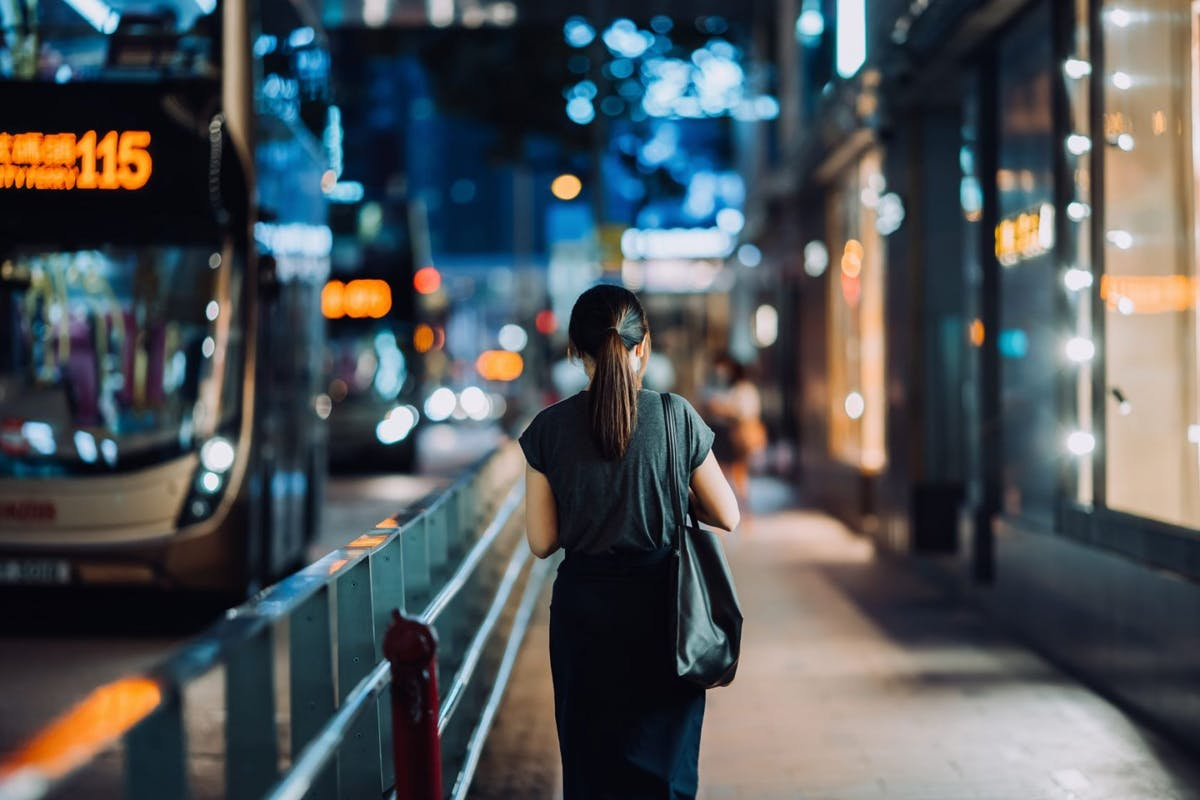 Woman with her back turned alone in a city