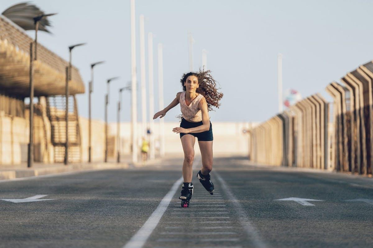 woman roller skating wind blown hair