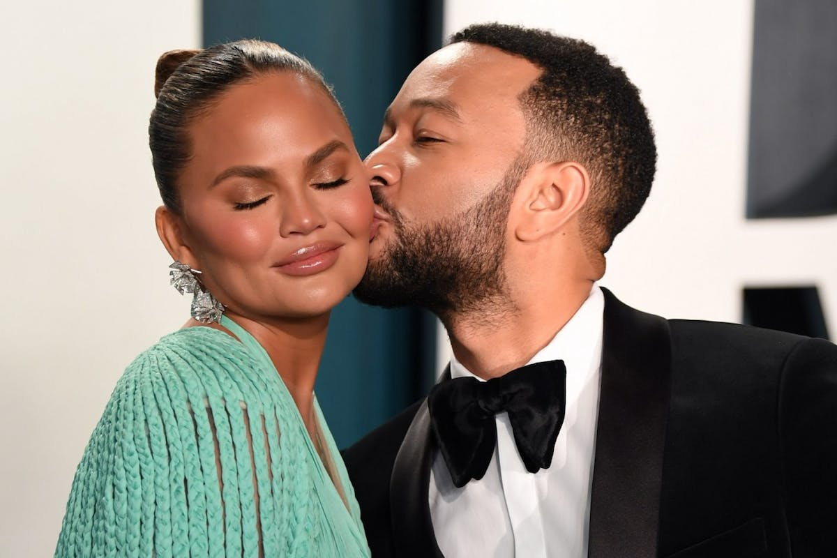 Chrissy Teigen and John Legend attend the 2020 Vanity Fair Oscar Party hosted by Radhika Jones at Wallis Annenberg Center for the Performing Arts on February 09, 2020 in Beverly Hills, California. (Photo by Karwai Tang/Getty Images)
