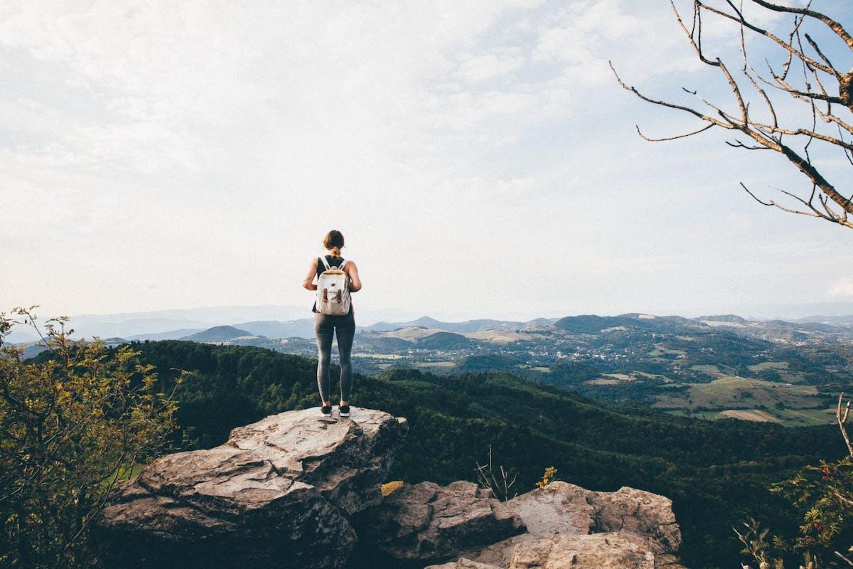 Woman walking in hills