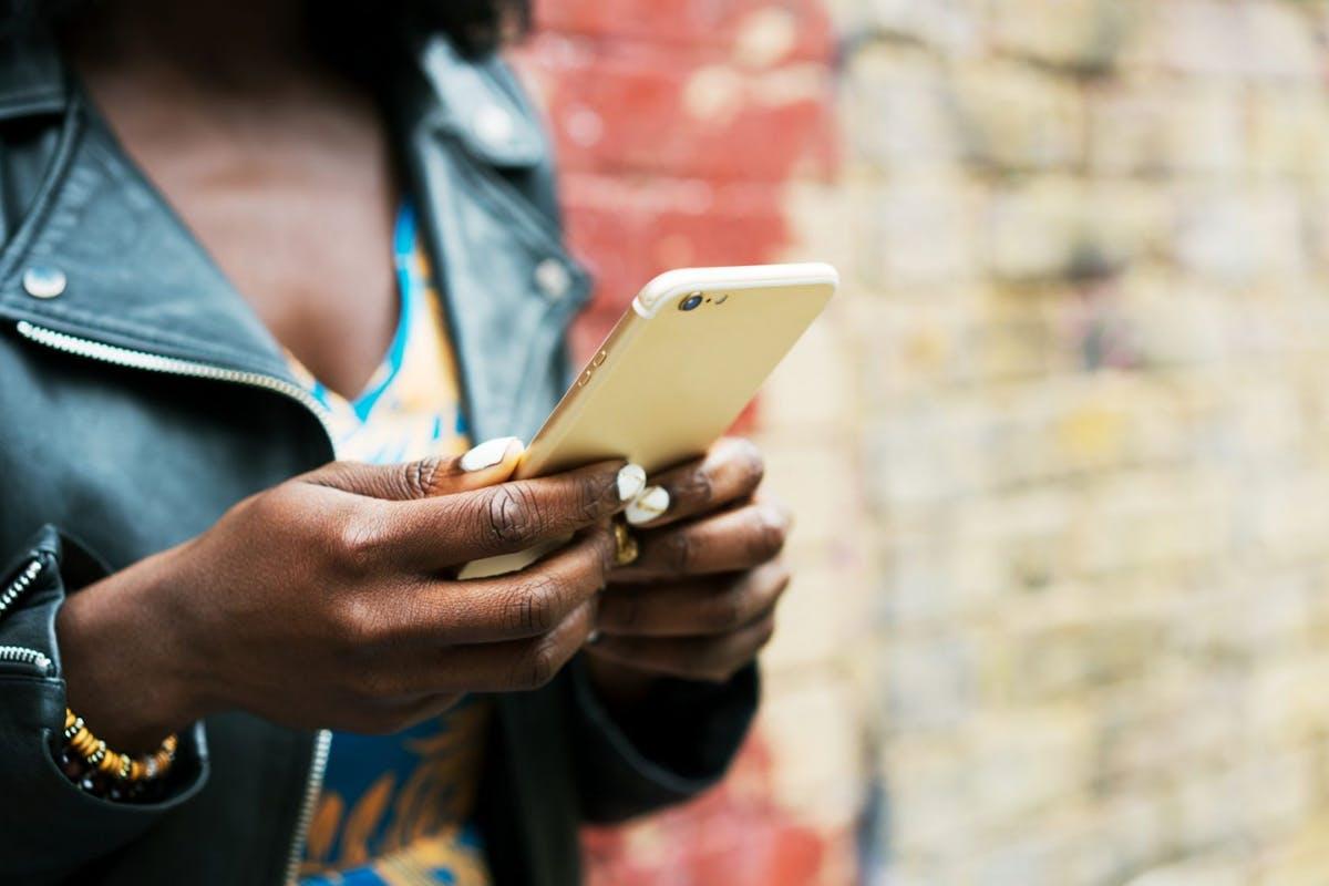 Woman sending WhatsApp messages