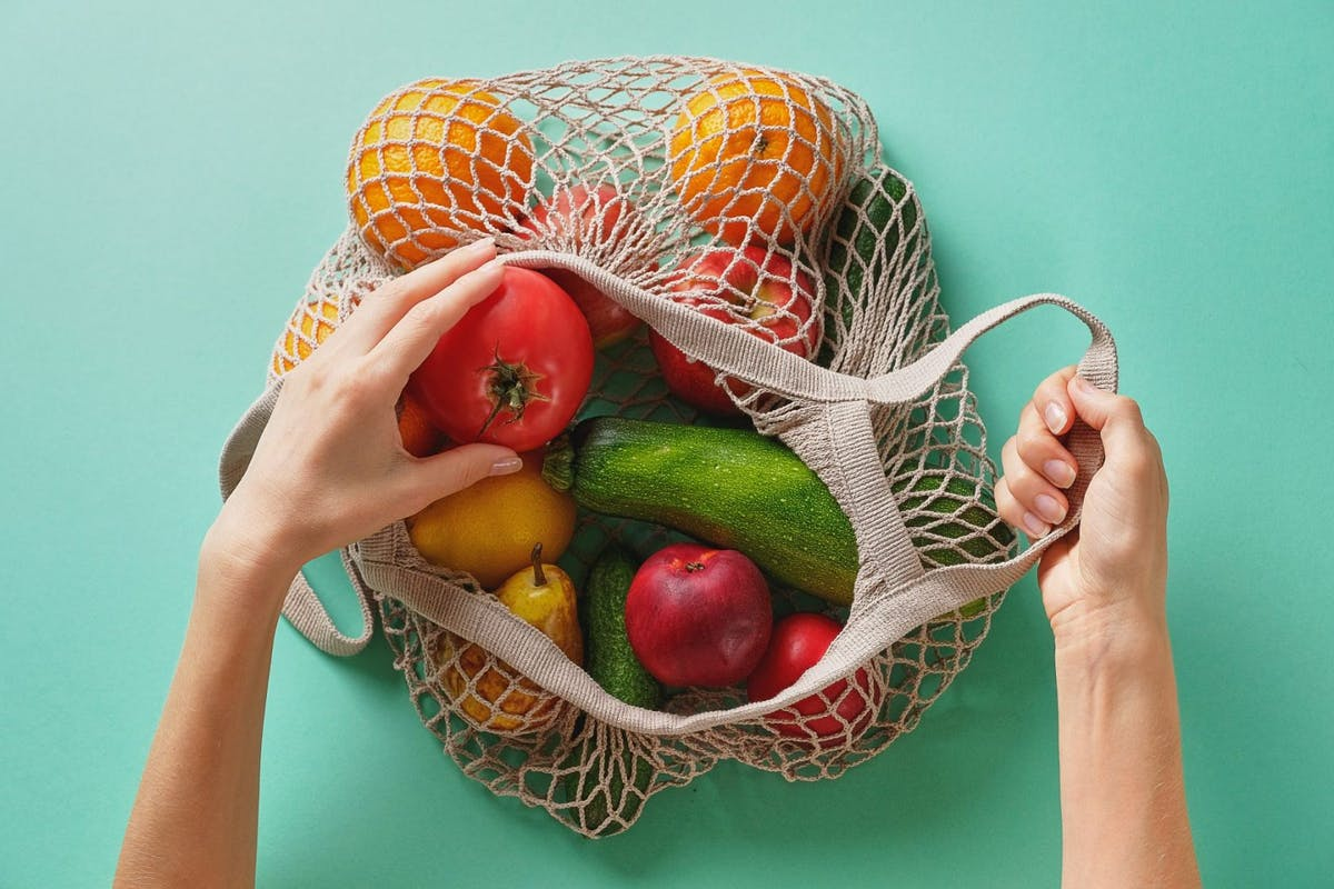 Juicy fruits and vegetables, products in a reusable shopping bag