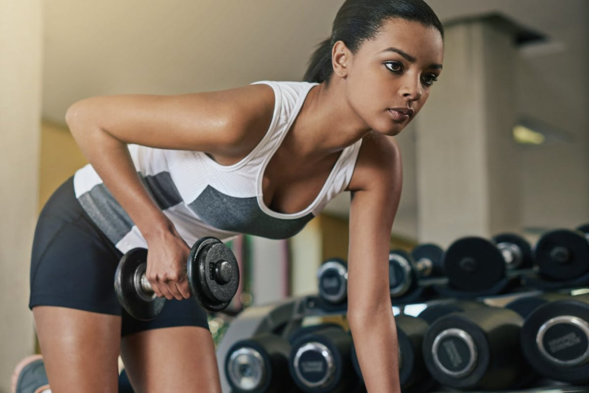 woman training with weights in the gym