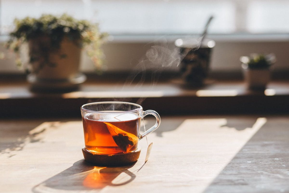 Green tea in a glass mug during summer