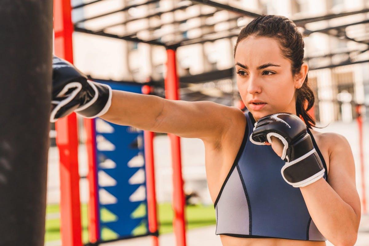 Boxing: woman hitting a punching bag