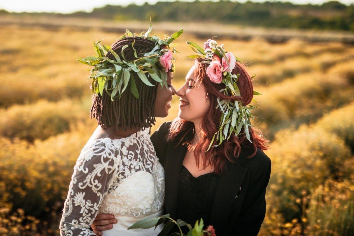 Two women getting married outside