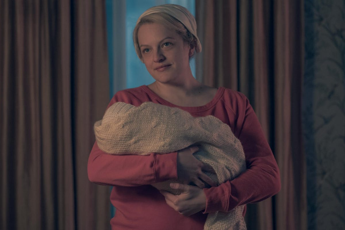 June (Elisabeth Moss) holds her baby in The Handmaid's Tale