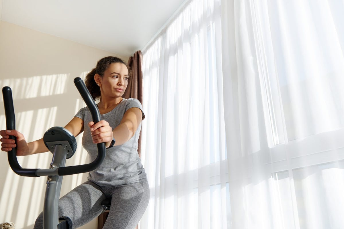 Woman riding an indoor exercise bike