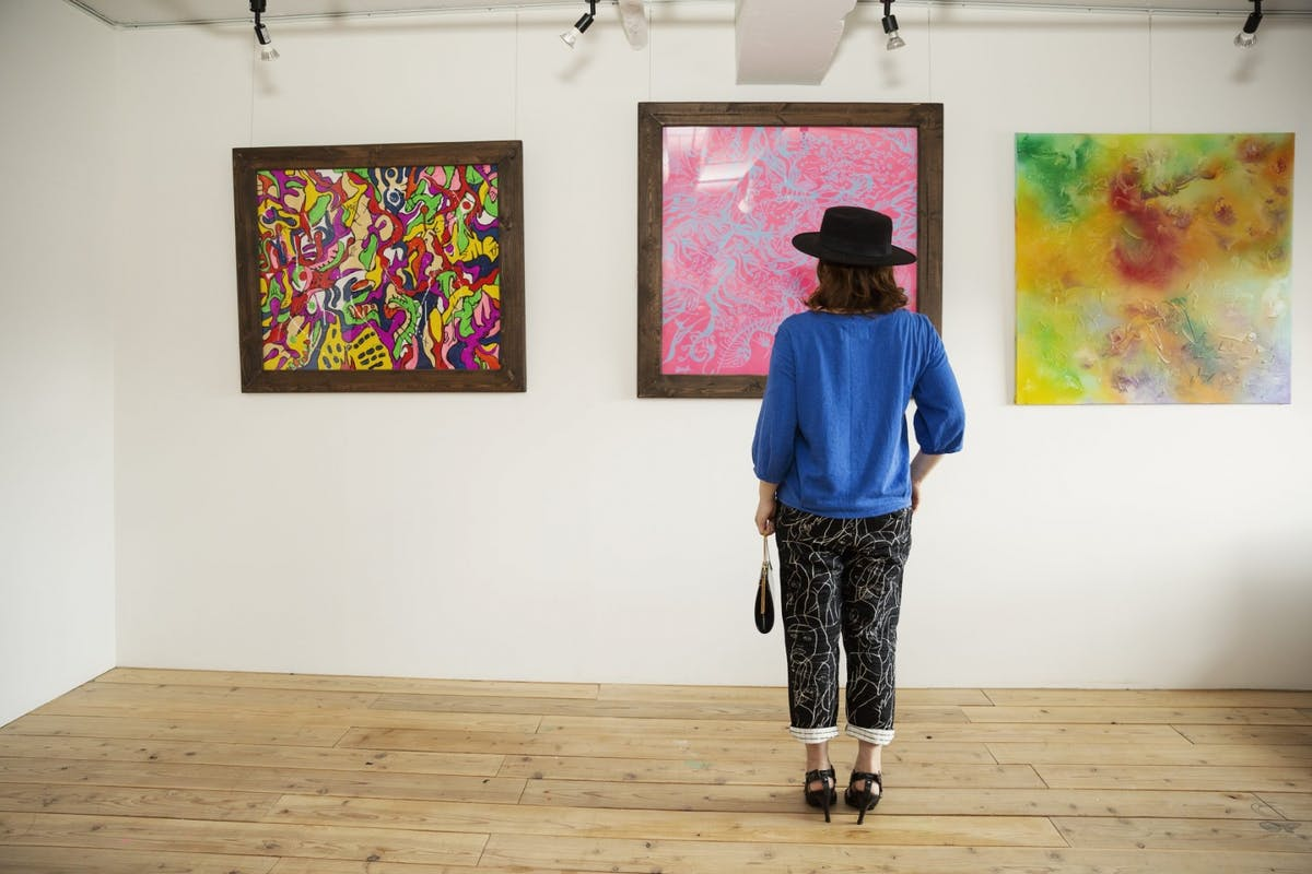 A woman looking at art in an exhibition