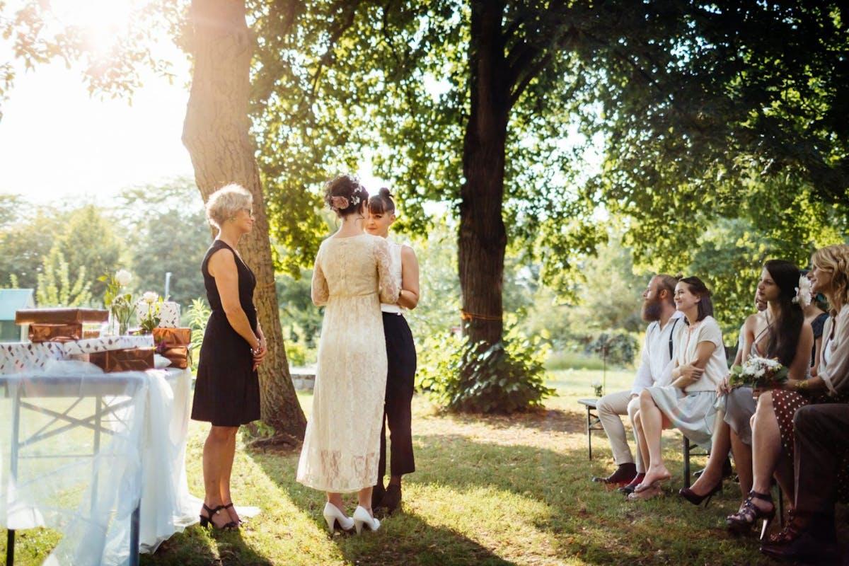 Two women having a garden wedding