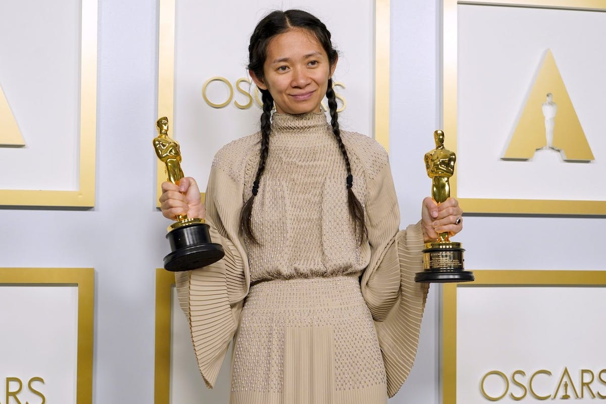 """Chloe Zhao, winner of Best Directing and Best Picture for """"Nomadland,"""" poses in the press room at the Oscars on Sunday, April 25, 2021, at Union Station in Los Angeles."""