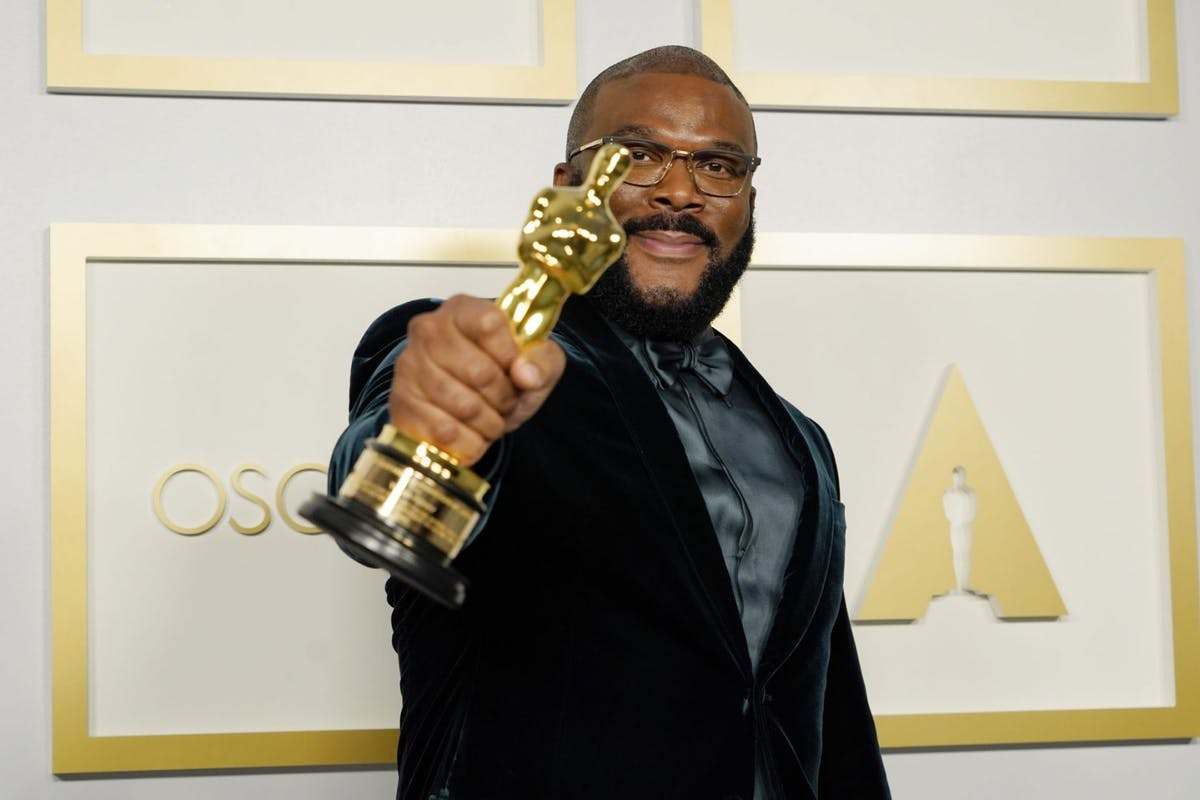 Tyler Perry, winner of the Jean Hersholt Humanitarian Award, poses in the press room during the Oscars on Sunday, April 25, 2021, at Union Station in Los Angeles. (Photo by Chris Pizzello-Pool/Getty Images)