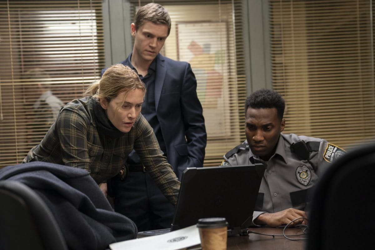 Kate Winslet as Mare Sheehan alongside Evan Peters and Justin Hurtt-Dunkley