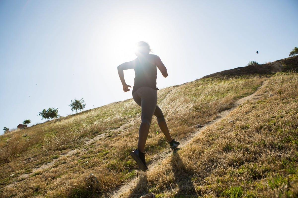 Woman hill sprinting