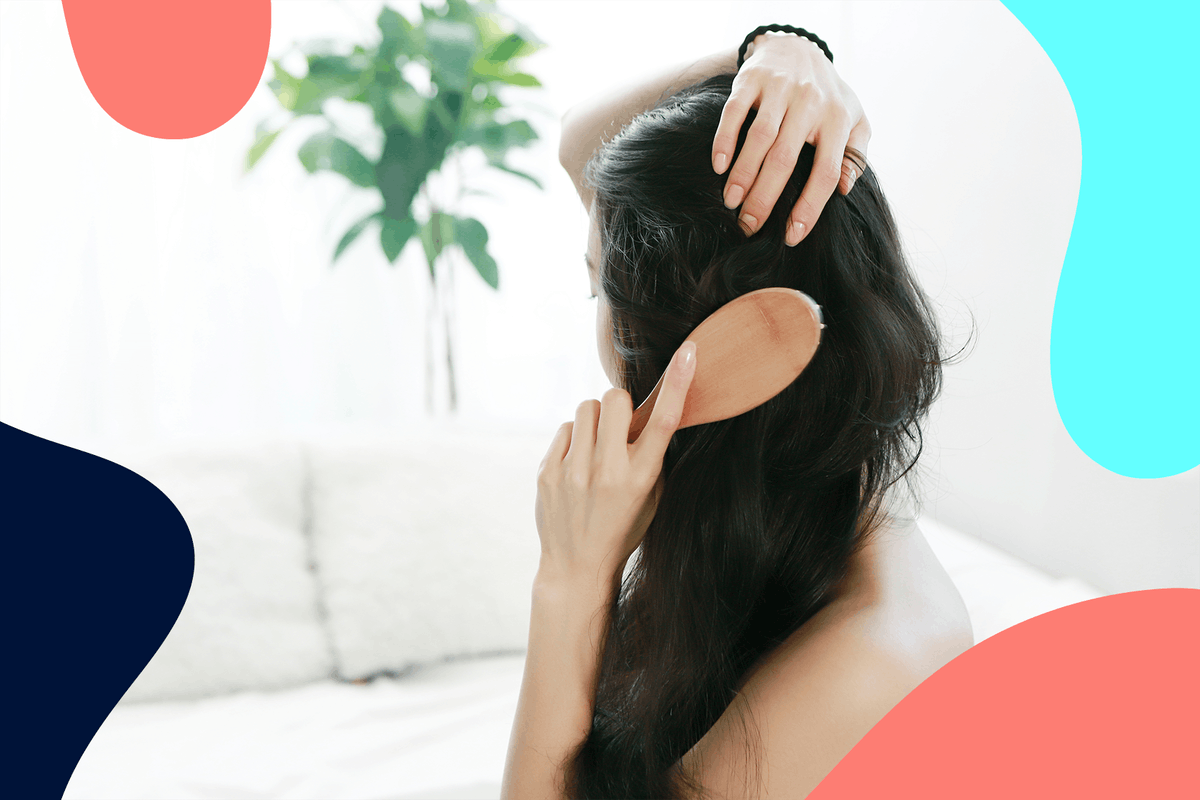 Woman brushing and caring for hair after experiencing hair loss