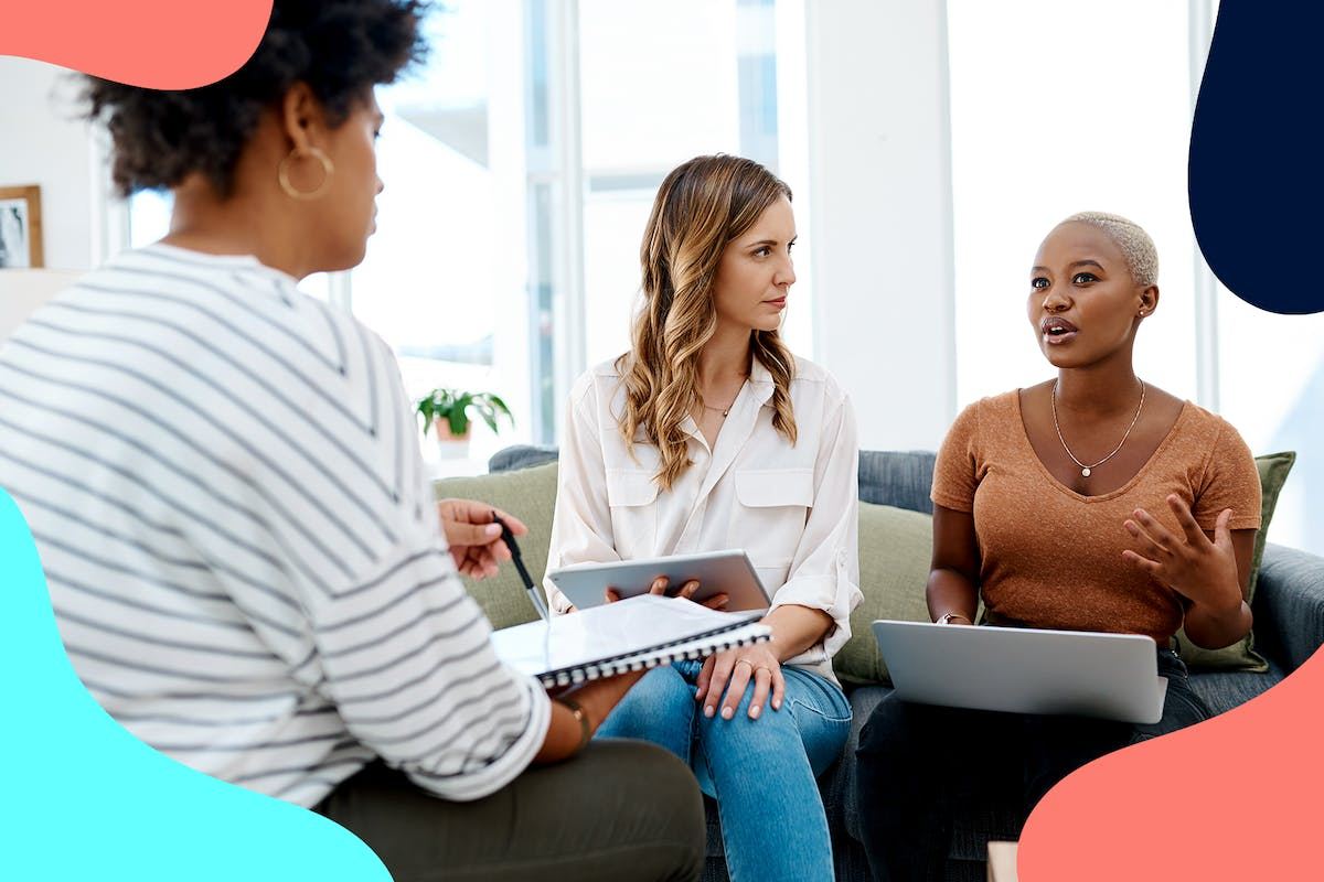 women discussing workplace inclusivity and diversity in the office