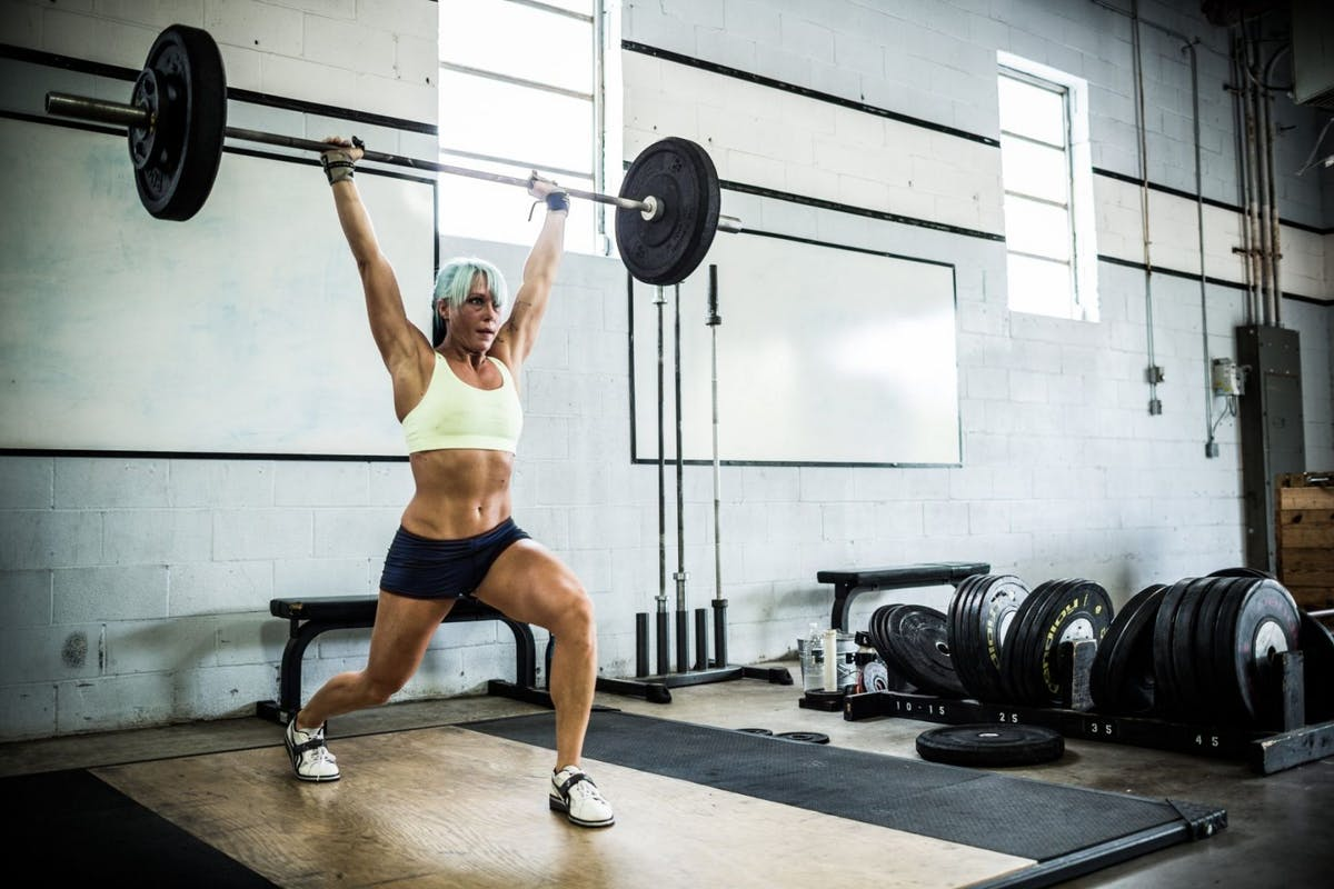 Strength training woman barbell