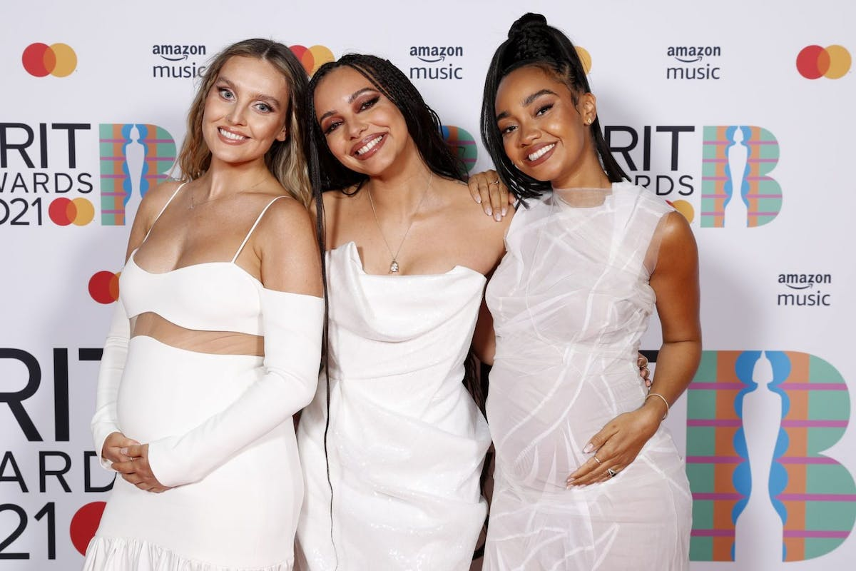 Perrie Edwards, Jade Thirlwall and Leigh-Anne Pinnock of Little Mix pose in the media room during The BRIT Awards 2021 at The O2 Arena on May 11, 2021 in London, England. (Photo by JMEnternational/JMEnternational for BRIT Awards/Getty Images)